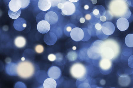 Blue and white holiday bokeh. Abstract Christmas background  photo