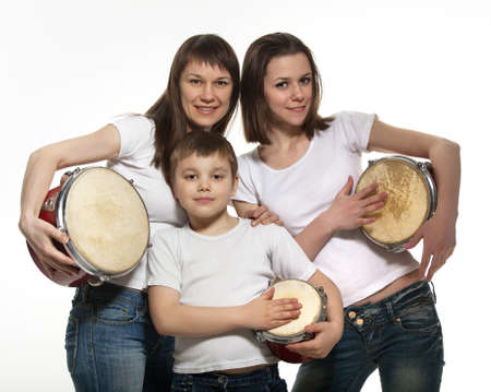 showman: Happy smiling mother with children with drums. Isolated on white
