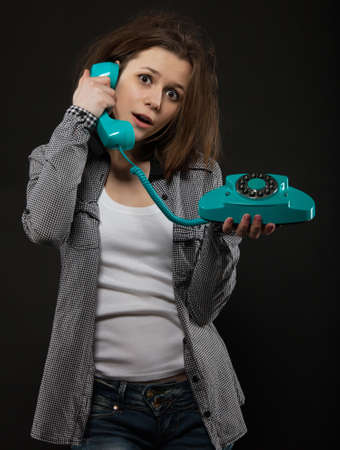 retro phone: Portrait of the funny teen girl with old phone