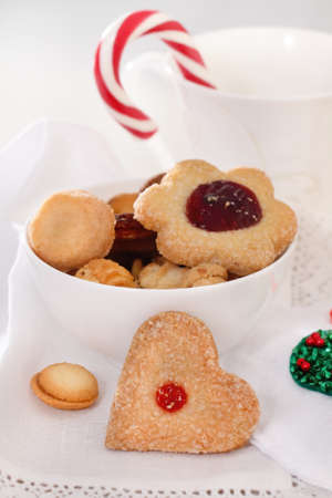 christmas scent: Homemade Christmas cookies decorated with jam on the white background