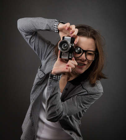 cute teen girl: Portrait of the cute teen girl with old camera Stock Photo