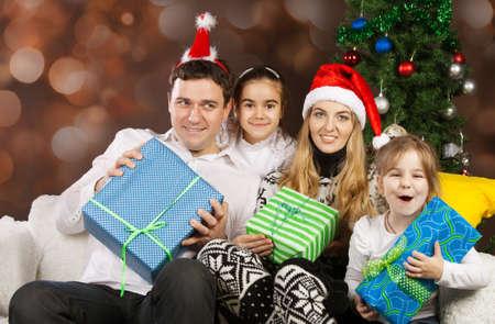 Happy family with Christmas presents near the Christmas tree Stock Photo - 15265320