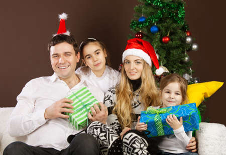 Happy family with Christmas presents near the Christmas tree Stock Photo - 15265317