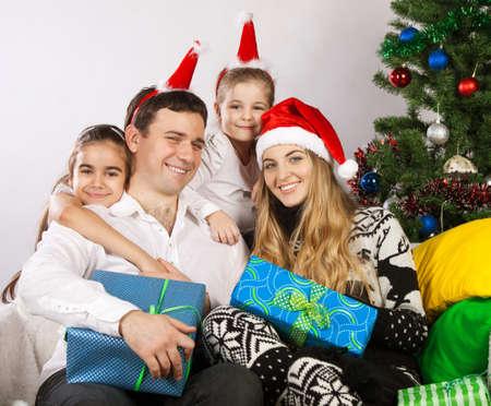 Happy family with Christmas presents near the Christmas tree Stock Photo - 15265331