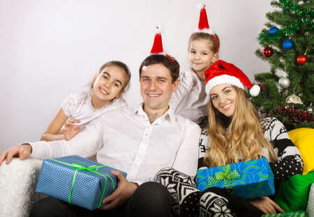 Happy family with Christmas presents near the Christmas tree Stock Photo - 15265319