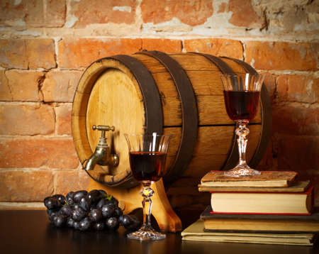 Retro still life with red wine, books and barrel photo
