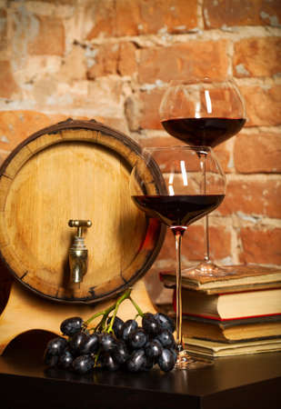 intoxicant: Retro still life with red wine, books and barrel Stock Photo