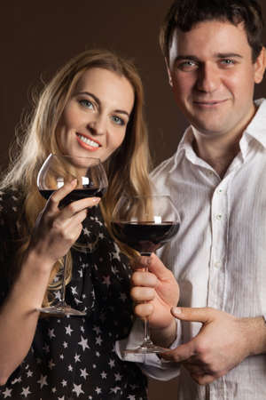 Young happy couple enjoying a glasses of red wine Stock Photo - 15366153