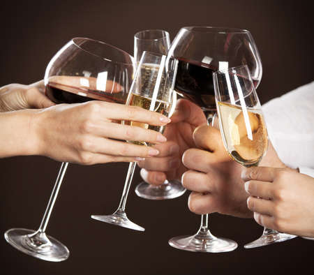 Celebration. People holding glasses of white wine making a toast Stock Photo - 15366146
