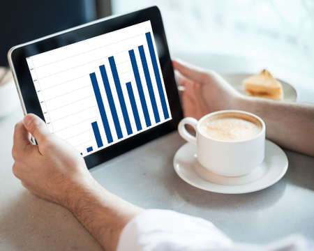 Man holding tablet computer with graphic in cafe Stock Photo - 15366132