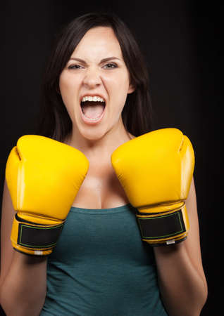 revenge: Emotional portrait of a girl in yellow boxing gloves