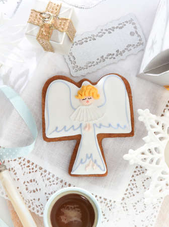Christmas angel cookies and decorations on the white background photo