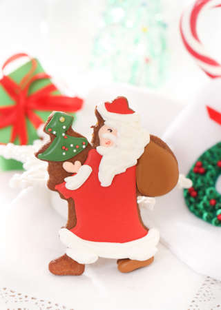 Christmas Santa cookies and decorations on the white background photo