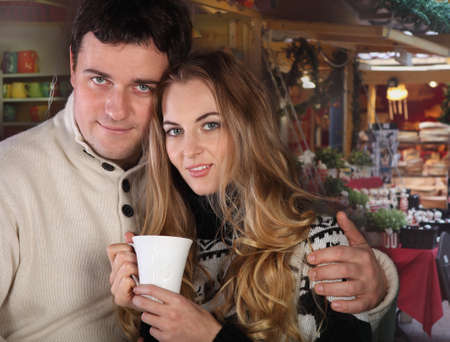 Portrait of a happy young couple on Christmas market  photo