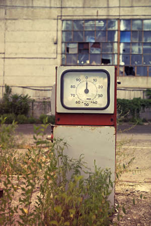 Damaged gas station close up in retro style photo