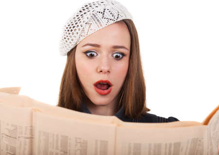 french model: Young cute brunette girl in parisian style look in shock at the newspaper Stock Photo