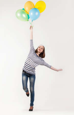 ballons: Young cute brunette girl in parisian style with ballons. Isolated Stock Photo
