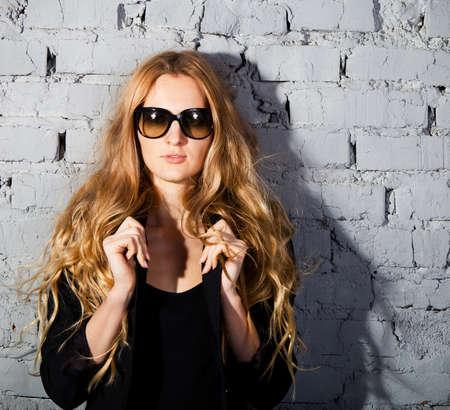 Beautiful girl with big black glasses. Close up portrait photo