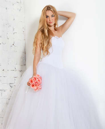 Portrait of a beautiful blond bride. Studio portrait photo