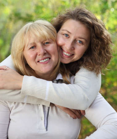 Middle age woman with her daughter outdoors Stock Photo - 16444056