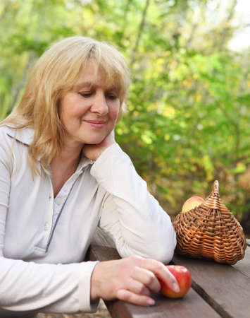 Portrait of the middle aged woman outdoors Stock Photo - 16472490