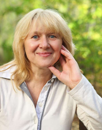 Middle aged woman looking at camera with happy smile Stock Photo - 16606164