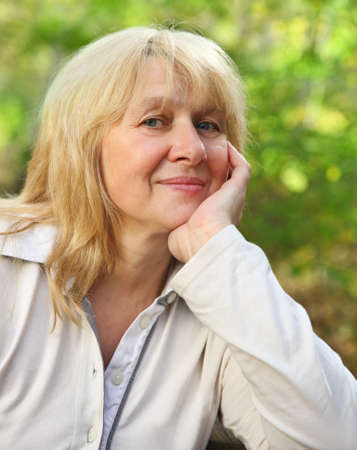 Middle aged woman looking at camera with happy smile Stock Photo - 16606168