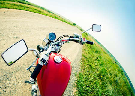 handlebars: Drivers view of the cockpit in a modern motorcycle on the country road Stock Photo