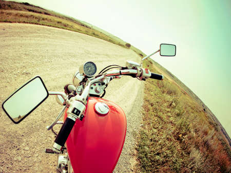 motor cycle: Drivers view of the cockpit in a modern motorcycle on the country road Stock Photo