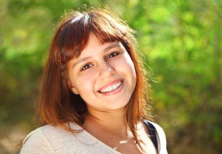 Happy smiling teen girl outdoors Stock Photo - 16606176
