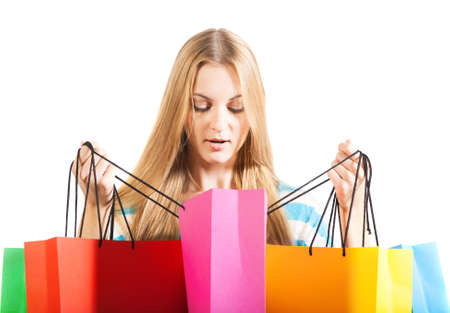 Young blond surprised woman after shopping Stock Photo - 16639803