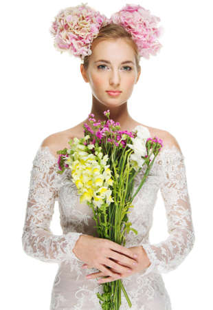 wedding portrait: Portrait of the beautiful blond girl with hydrangea in her hair Stock Photo