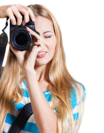 takes: Creative woman photographer takes photos. Isolated on white