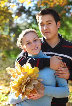 Happy young couple in love outdoors photo