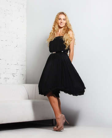 Portrait of the beautiful blond girl in black dress Stock Photo - 16883481
