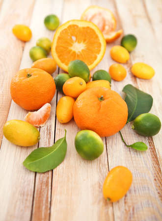 Fresh citrus fruits on the wooden rustic table photo