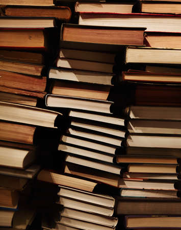 Pile of old dirty books on book shelf. Background Stock Photo - 16960956