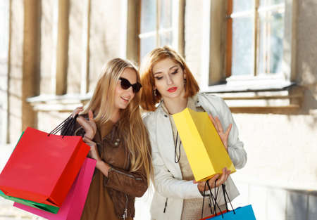 Young happy women with shopping bags outdoors Stock Photo - 17052726