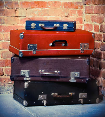 Old vintage suitcases isolated near brick wall. Luggage Stock Photo - 17068772