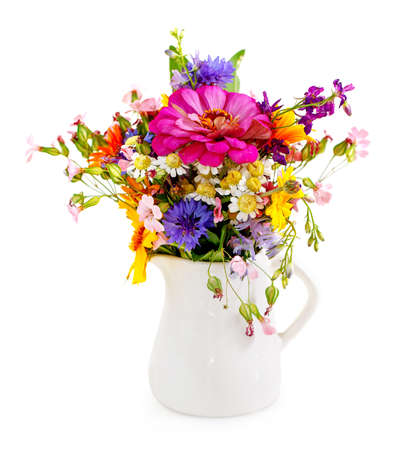 flower vase: Bouquet of flowers in the white vase isolated on white
