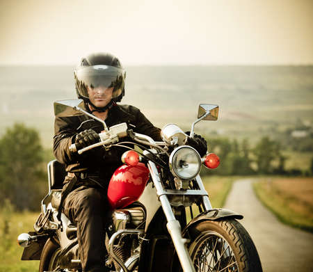 motor sport: Biker on the country road against the sky Stock Photo