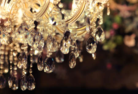Chrystal chandelier close-up. Glamour background with copy space photo
