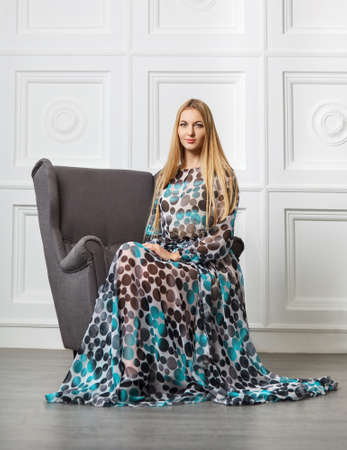 Portrait of the beautiful blond girl in long dress Stock Photo - 17566253