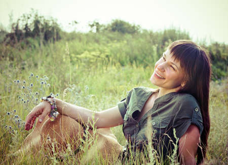 Smiling brunette woman in sunny summer day photo