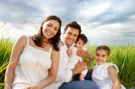 fun colors:  Happy young family with two children outdoors