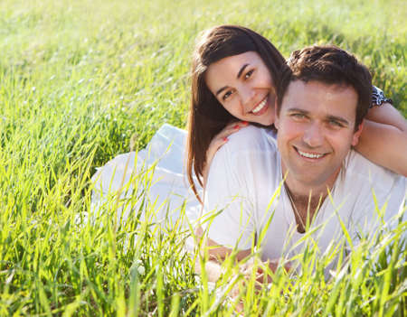 Young happy couple in love in spring day. Outdoors potrait photo