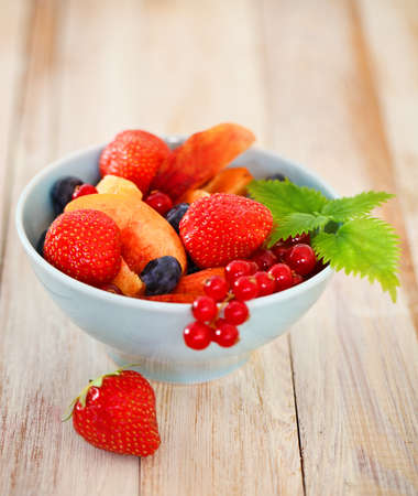 fruity salad: Delicious fresh fruits served in bowl as dessert Stock Photo