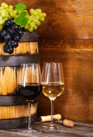 intoxicant: Still life with glasses of the red and white wine and barrel