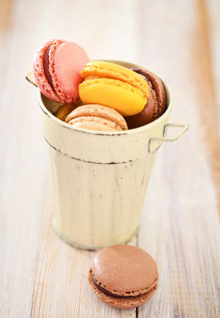 dessert stand: French macaroons in the cup. Close up. DOF