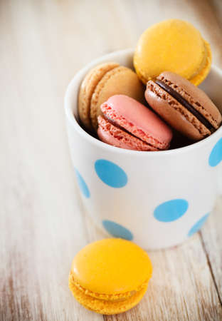French macaroons in the cup. Close up. DOF photo